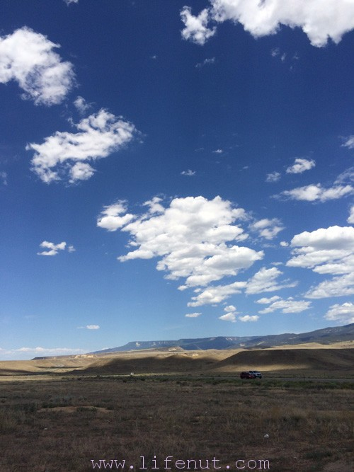The south side of the Grand Mesa from off Highway 50, running through the desert.