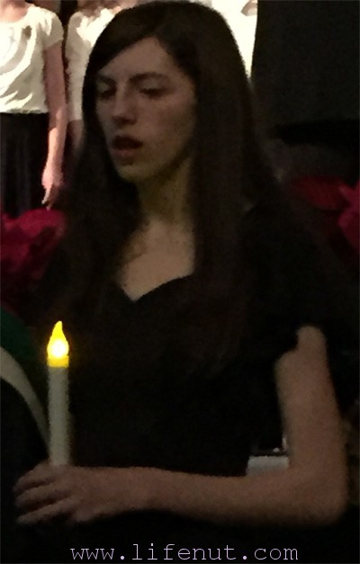 Aidan, singing at her last high school holiday concert. The tradition is for seniors to enter the auditorium holding candles. It was very emotional because I remember that concert when she was a freshman, watching the seniors, thinking her moment was far off. Nope. :cry: