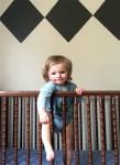 Ollie, smaller, behind bars.